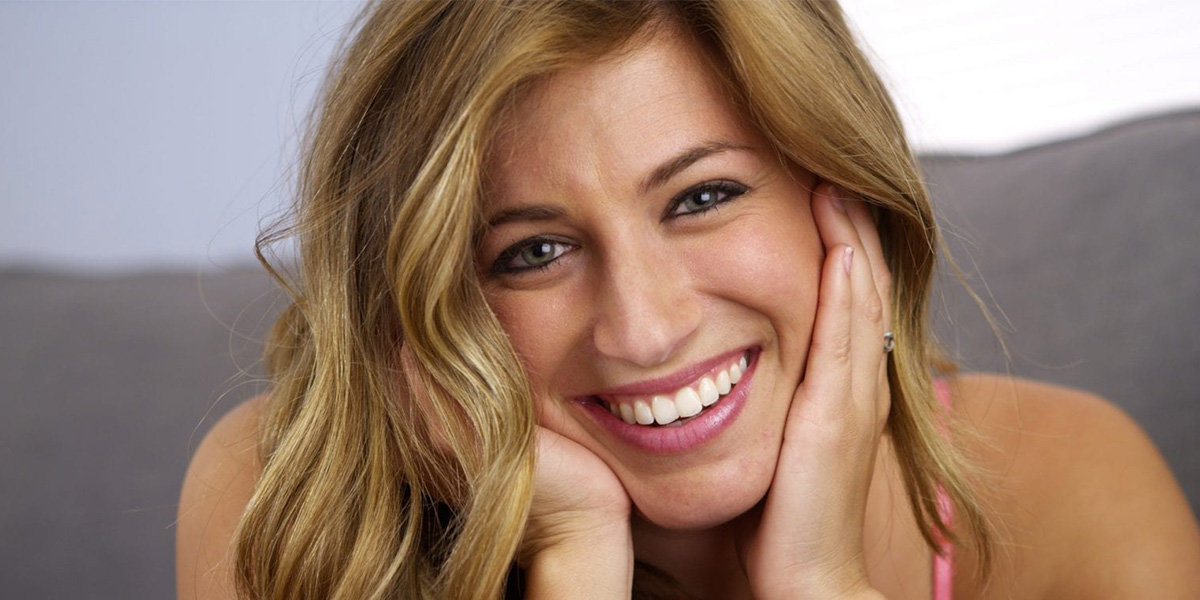 how does gum contouring improve a gummy smile